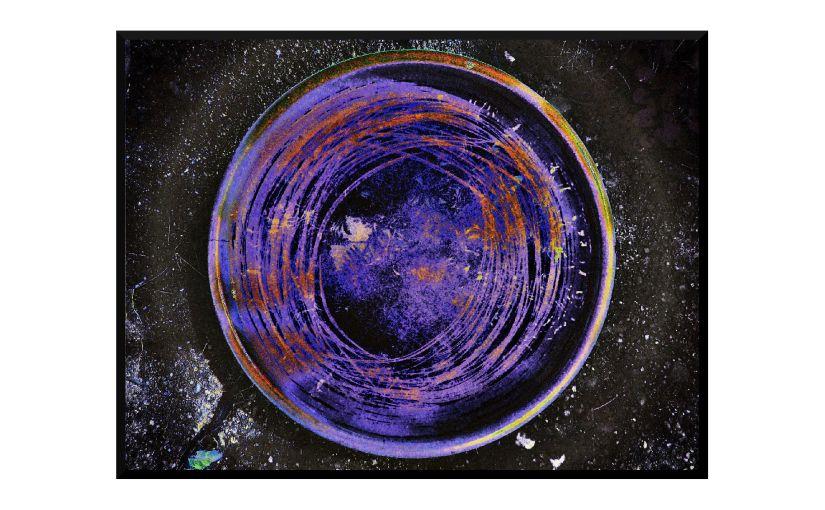 Illustration: birdbath photo digitally manipulated to suggest a miniature indigo lake on cracked concrete, illuminated by a streetlight